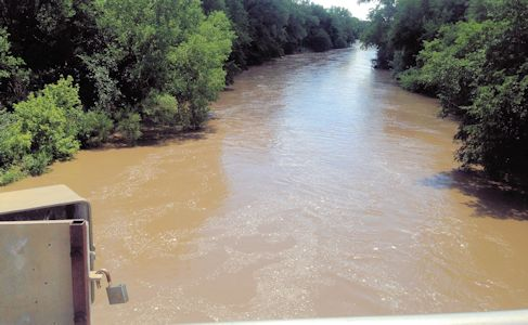 2,160 cfs at Smoky Hill River at Ellsworth, KS on July 26, 2013. Photo by Travis See, USGS.