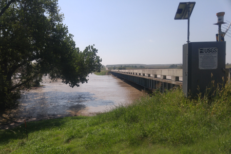 14,200 cfs at Saline River near Russell, KS on Sept. 4, 2016. Photo by Andrew Clark, USGS.