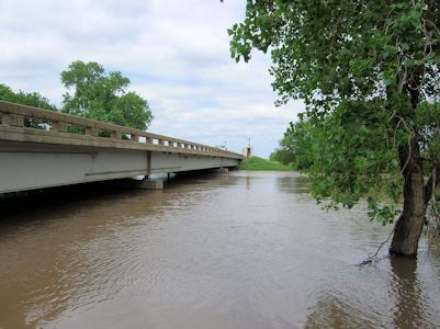 31,700 cfs at Smoky Hill River at New Cambria, KS on May 25, 2007. Photo by Brian Loving, USGS.