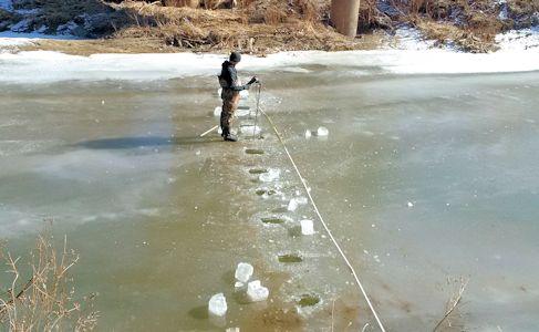 Ice measurement at Stranger Creek near Potter, KS on Jan. 14, 2015. Photo by Dirk Hargadine, USGS.