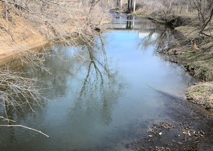 Downstream at Cedar Creek at 95th Street near DeSoto, KS on Apr. 2, 2013. Photo by Craig Painter, USGS.
