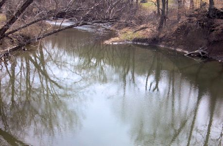 Upstream at Cedar Creek at 95th Street near DeSoto, KS on Apr. 2, 2013. Photo by Craig Painter, USGS.