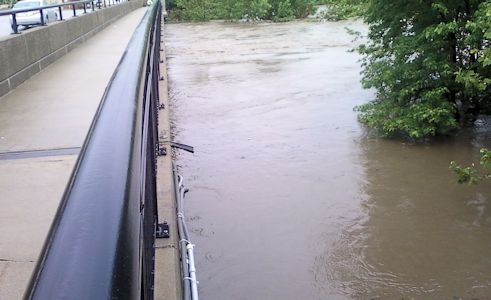 13,800 cfs at Indian Creek at State Line Road, KS on May 31, 2013. Photo by Pat Finnegan, USGS.