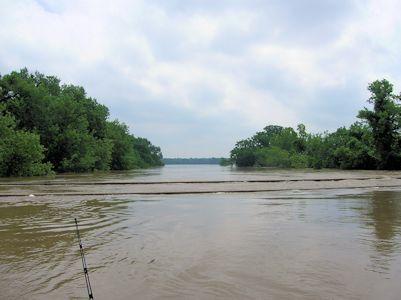 134,000 cfs at Marais des Cygnes River near KS-MO State Line, KS on July 2, 2007. Photo by Brian Loving, USGS.