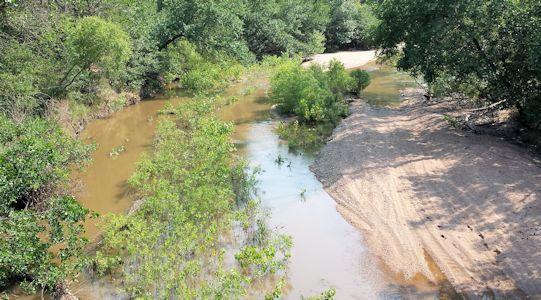 33.2 cfs at Arkansas River near Larned, KS on Aug. 19, 2013. Photo by Nathan Sullivan, USGS.