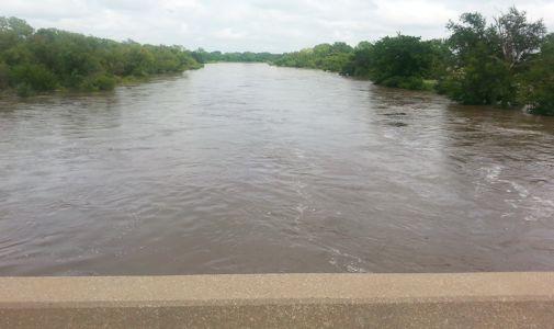 9,910 cfs at Arkansas River near Hutchinson, KS on Aug. 4, 2013. Photo by Chris Moehring, USGS.