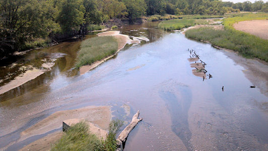 27.0 cfs at Arkansas River near Hutchinson, KS on July 26, 2012. Photo by Chris Moehring, USGS.