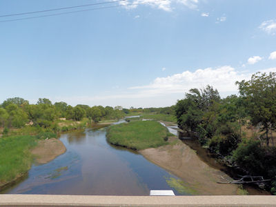 30.1 cfs at Arkansas River near Hutchinson, KS on July 5, 2012. Photo by Sonja McDanel, USGS.