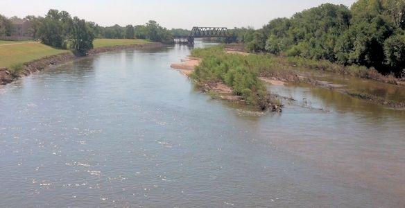 1,180 cfs at Arkansas River at Wichita, KS on Aug. 26, 2013. Photo by Slade Hackney, USGS.