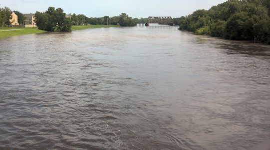 14,700 cfs at Arkansas River at Wichita, KS on Aug. 5, 2013. Photo by Mike Holt, USGS.