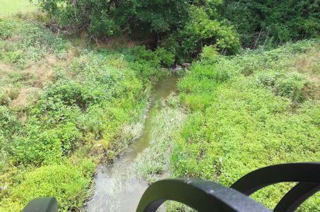 1.10 cfs at Calfskin Creek at 119th Street, Wichita, KS on July 25, 2013. Photo by Chris Moehring, USGS.