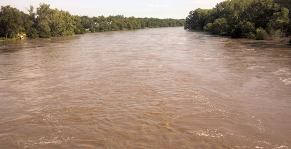 27,500 cfs at Arkansas River at Derby, KS on Aug. 5, 2013. Photo by Mike Holt, USGS.