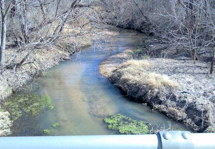 7.77 cfs at South Fork Ninnescah River near Pratt, KS on Feb. 13, 2013. Photo by Chris Moehring, USGS.
