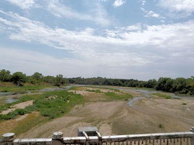 110 cfs at Arkansas River at Arkansas City, KS on Aug. 7, 2012. Photo by Chris Moehring, USGS.