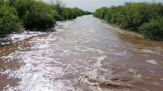 7,430 cfs at Grouse Creek near Silverdale, KS on May 17, 2015. Photo by Slade Hackney, USGS.