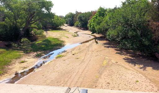 0.06 cfs at Medicine Lodge River near Kiowa, KS on July 8, 2013. Photo by Chris Moehring, USGS.