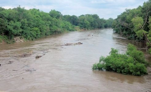 16,100 cfs at Verdigris River at Coffeyville, KS on July 30, 2013. Photo by Arin Peters, USGS.