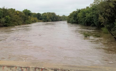 32,000 cfs at Verdigris River at Coffeyville, KS on Oct. 10, 2014. Photo by Arin Peters, USGS.