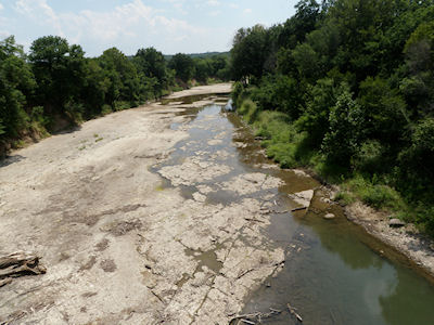 0.09 cfs at Caney River near Elgin, KS on July 11, 2012. Photo by Chris Moehring, USGS.