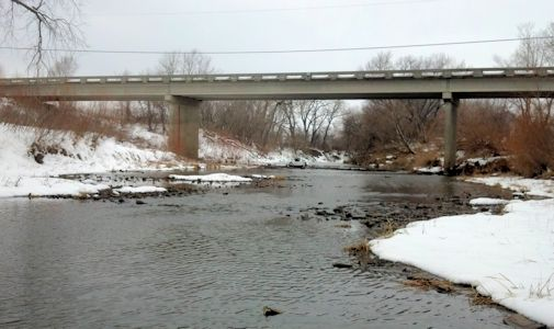 7.6 cfs at Neosho River at Burlingame Road near Emporia, KS on Feb. 28, 2013. Photo by Arin Peters, USGS.