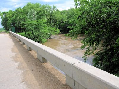 3,810 cfs at Cedar Creek near Cedar Point, KS on May 27, 2008. Photo by Brian Loving, USGS.
