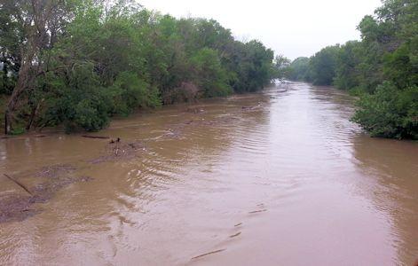 10,400 cfs at Neosho River at Neosho Rapids, KS on July 31, 2013. Photo by Anita Kroska, USGS.