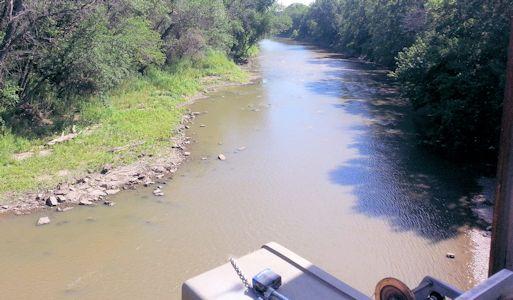 109 cfs at Neosho River at Neosho Rapids, KS on June 26, 2013. Photo by Anita Kroska, USGS.
