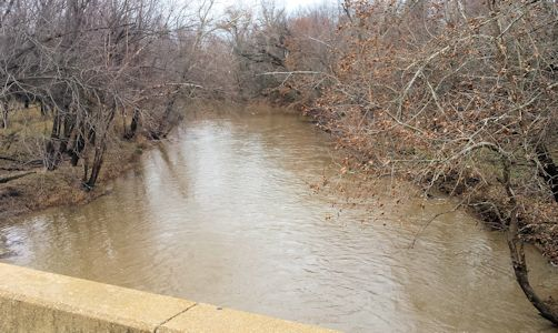 411 cfs at Cow Creek near Scammon, KS on Dec. 15, 2014. Photo by Arin Peters, USGS.
