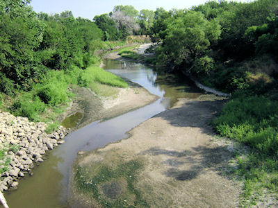 2.1 cfs at Little Arkansas River upstream of ASR Facility near Sedgwick, KS on July 13, 2012. Photo by Carl Collins, USGS.