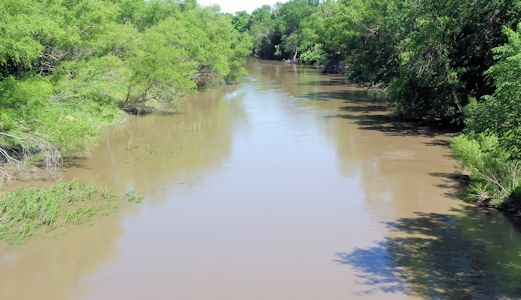 976 cfs at Little Arkansas River upstream of ASR Facility near Sedgwick, KS on June 2, 2013. Photo by Trudy Bennett, USGS.